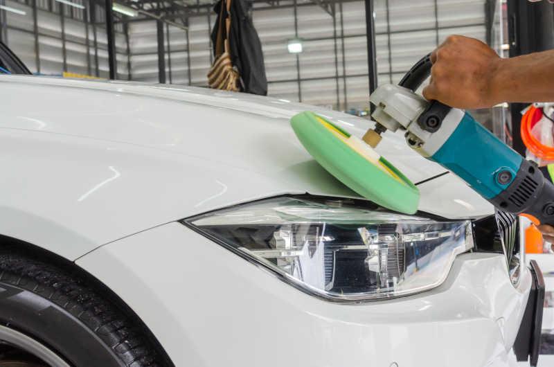 expert exterior detailing of a car using modern equipment